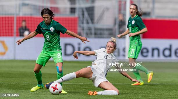Kathrin Hendrich of Germany challenges Mateja Zver of Slovenia during the 2019 FIFA women's World Championship qualifier match between Germany and...