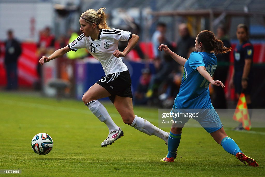 Kathrin Hendrich (L) of Germany eludes Barbara Kralj of Slovenia during the FIFA Women's World Cup 2015 qualifying match between Germany and Slovenia at Carl-Benz-Stadion on April 10, 2014 in Mannheim, Germany.