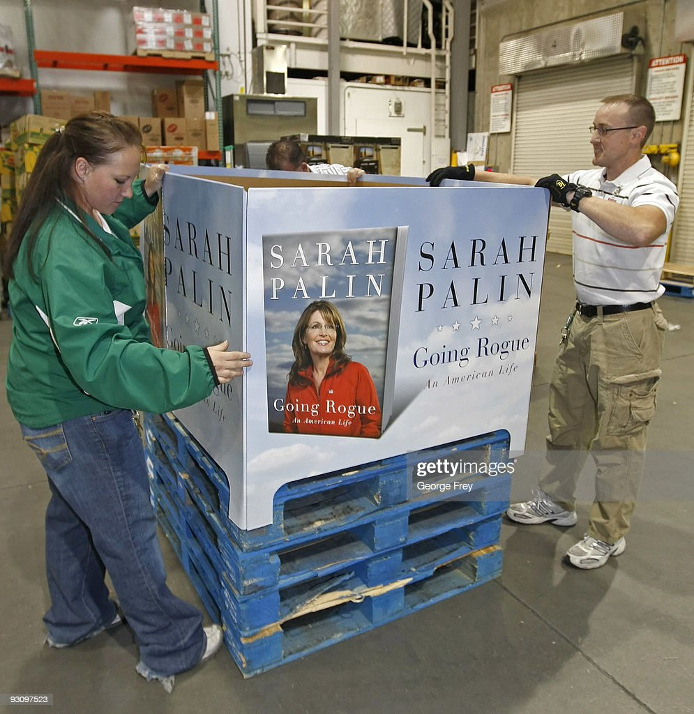 retailers prepare for release of sarah palin s memoir photos and kathrina norris l and jason holt r prepare a display for copies