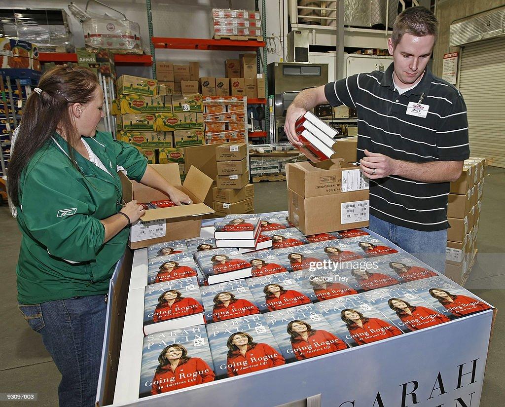 retailers prepare for release of sarah palin s memoir photos and kathrina norris l and matt cross r put copies of sarah palin s
