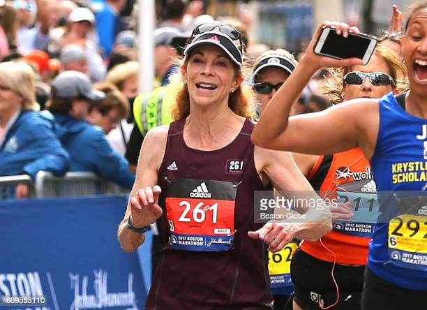 Kathrine Switzer crosses the finish line after she complete the 121st Boston Marathon on April 17 2017