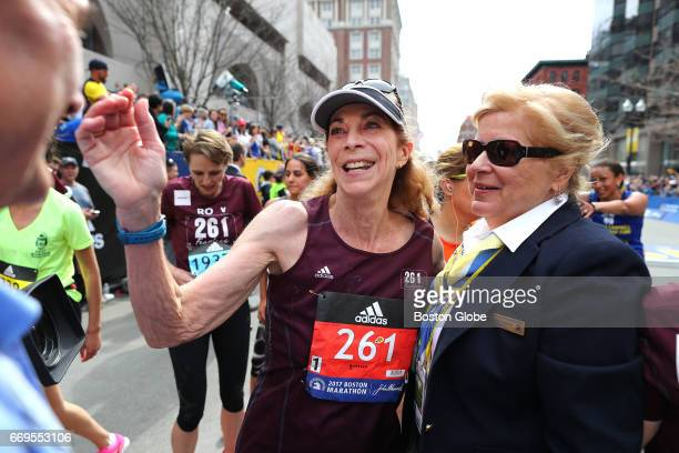 Kathrine Switzer is welcomed across the finish line by BAA President Joann Flaminio after she complete the 121st Boston Marathon on April 17 2017