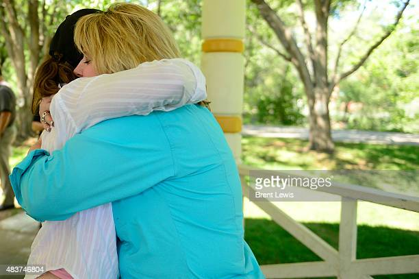 Kathryn Bucher hugs Cynthia Coffman the Attorney General of Colorado after asking about what she can do to help out with the wastewater situation...