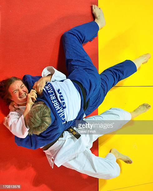 Kathryn Chamberlain of Great Britain holds Catherine Stephant Benoit of France for ippon on her way to winning the F5 u70kgs gold medal during the...