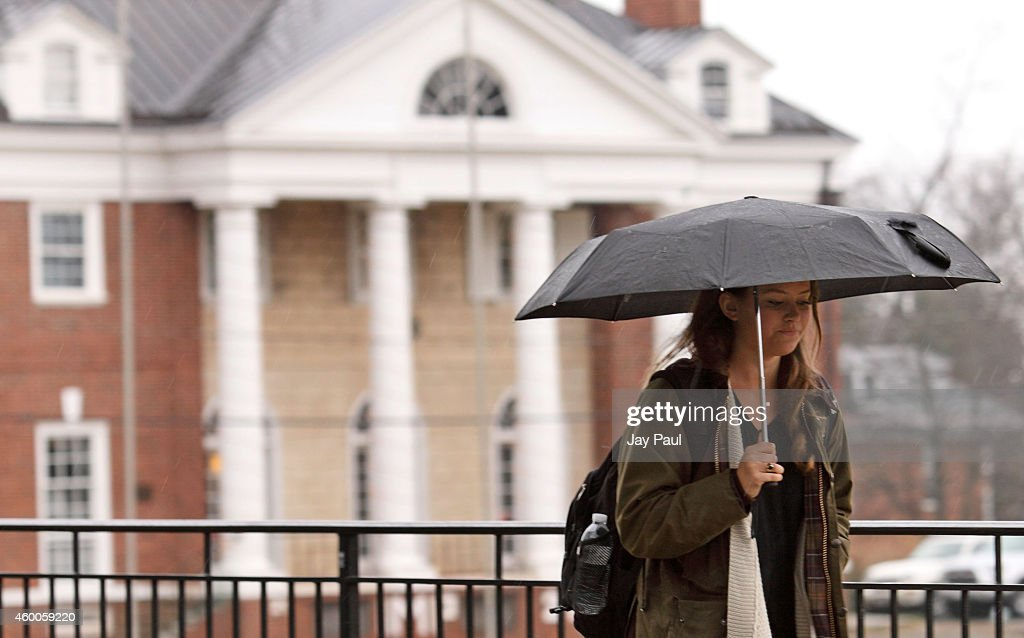 Kathryn Dockter, at third year student at the University of Virginia, walks past the Phi Kappa Psi fraternity house on December 6, 2014 in Charlottesville, Virginia. On Friday, Rolling Stone magazine issued an apology for discrepencies that were published in an article regarding the alleged gang rape of a University of Virginia student by members of the Phi Kappa Psi fraternity.