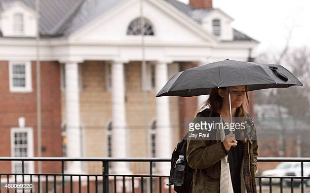 Kathryn Dockter at third year student at the University of Virginia walks past the Phi Kappa Psi fraternity house on December 6 2014 in...