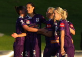 Kathryn Gill of the Glory celebrates a goal with team mates during the round 12 WLeague match between the Perth Glory and Western Sydney Wanderers at...