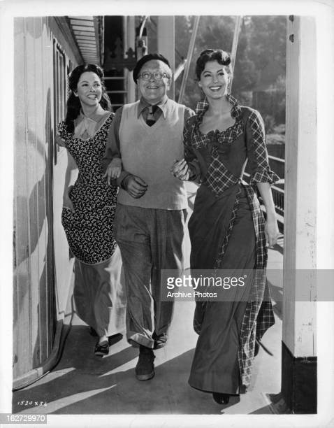 Kathryn Grayson cameraman Charles Rosher and Ava Gardner take a turn around the deck of the Cotton Blossom between scenes of the film 'Show Boat' 1951