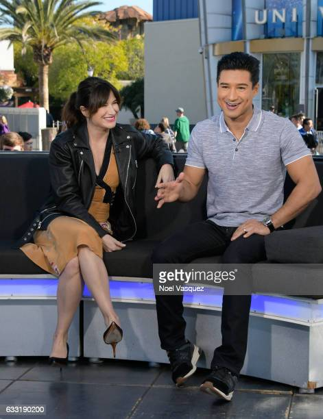 Kathryn Hahn and Mario Lopez visit 'Extra' at Universal Studios Hollywood on January 31 2017 in Universal City California