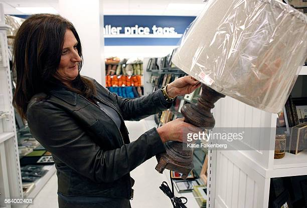 kathryn ireland of bravos million dollar decorators inspects a lamp she likes at marshalls - Million Dollar Decorators