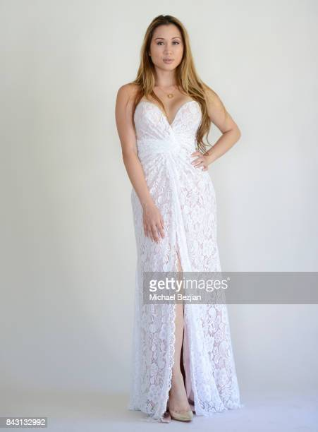 Kathryn Le poses for portrait wearing a white lace dress by Dalia McPhee Fashions at TAP The Artists Project Style House Welcomes Kathryn Le on...