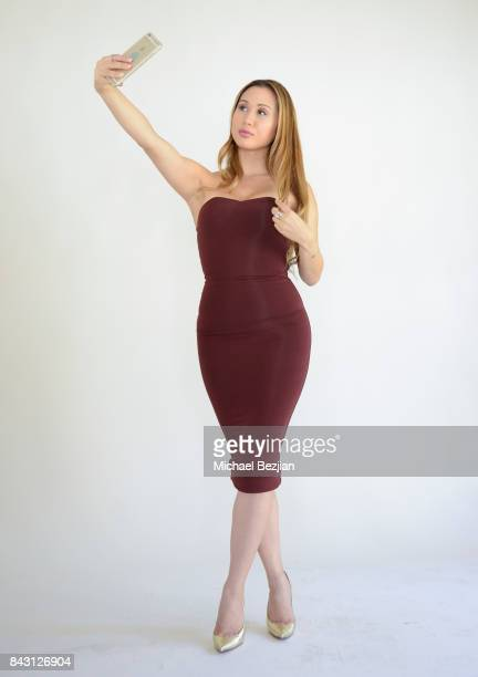 Kathryn Le takes a selfie wearing a maroon seamless dress by Oh Polly and Sterling Forever rings at TAP The Artists Project Style House Welcomes...