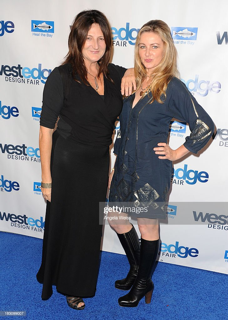 Kathryn M Ireland and guest attend the WestEdge Design Fair opening night benefiting Heal the Bay at Barker Hangar on October 3, 2013 in Santa Monica, California.