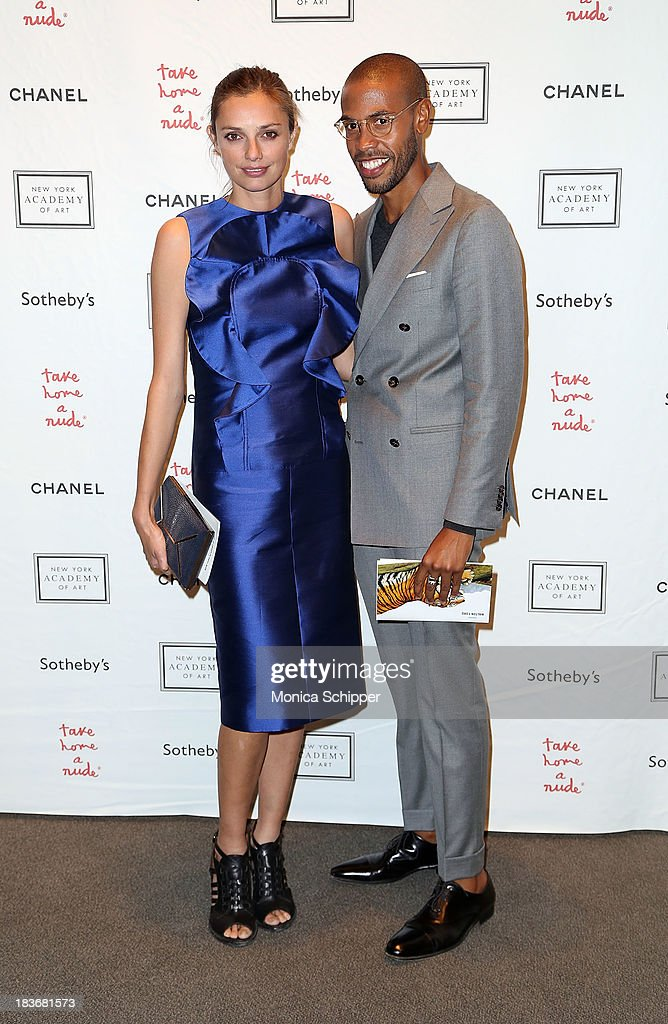 (L-R Kathryn Neale and Charles Harbison attend 2013 'Take Home A Nude' Benefit Art Auction And Party at Sotheby's on October 8, 2013 in New York City.