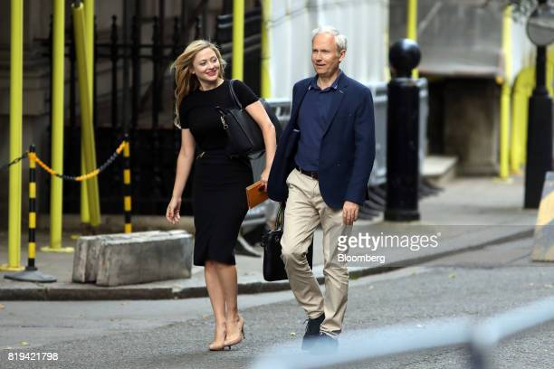 Kathryn Parsons cofounder of Decoded left and Luke Johnson cofounder of Risk Capital Partners LLP arrive in Downing Street for a business advisory...