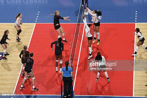 Kathryn Plummer of Stanford University attempts a kill against the University of Texas during the Division I Women's Volleyball Championship held at...
