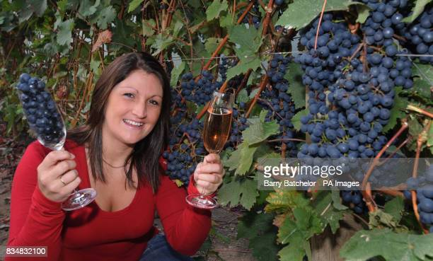 Kathryn Richards poses with a glass of wine made at the Camel Valley Vineyard in Nanstallon near Bodmin Cornwall