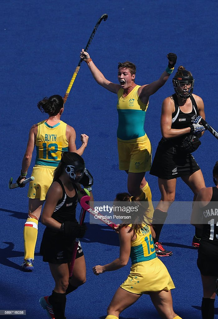 Kathryn Slattery of Australia celebrates with Madonna Blyth after scoring against New Zealand during the quarter final hockey game on Day 10 of the...