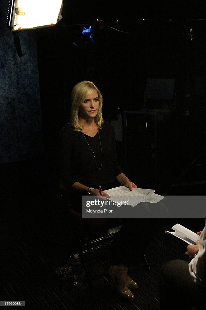 Kathryn Tappen prepares for a NHL Network interview at the 2013 NHL Player Media Tour at the Prudential Center on September 5, 2013 in Newark, New Jersey.