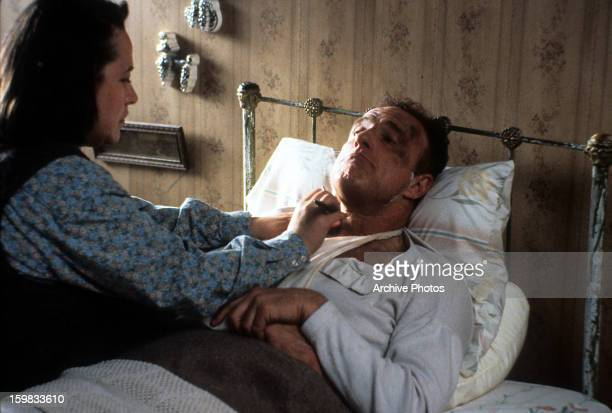 Kathy Bates watches over James Caan in a scene from the film 'Misery' 1990