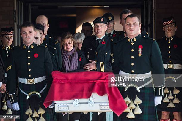Kathy Cirillo the mother of Cpl Nathan Cirillo follows the casket carrying her son two days after he was shot dead by a gunman while he guarded the...