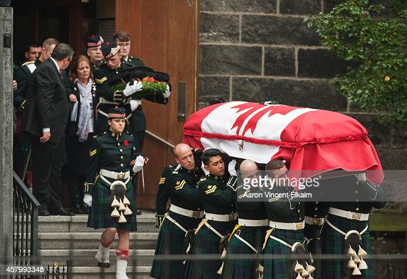 Kathy Cirillo walks out from the Christ's Church Cathedral as the casket of her son Cpl Nathan Cirillo is carried out during his funeral on October...