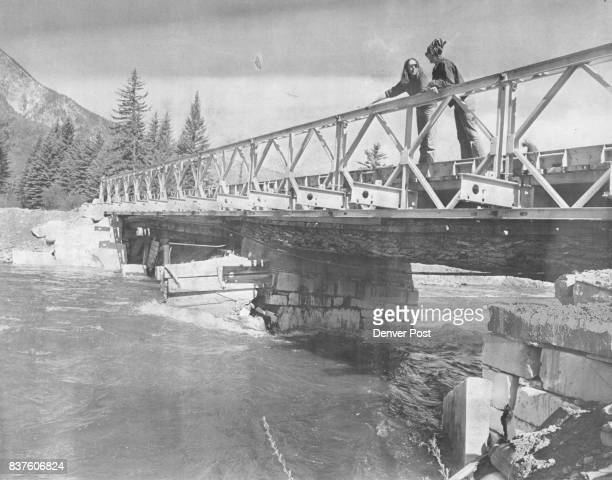 Kathy Corey Left and Phyllis Jaeger Survey the Remains of an Old Bridge The Bridge over the Crystal River that the Gunnison County residents are...