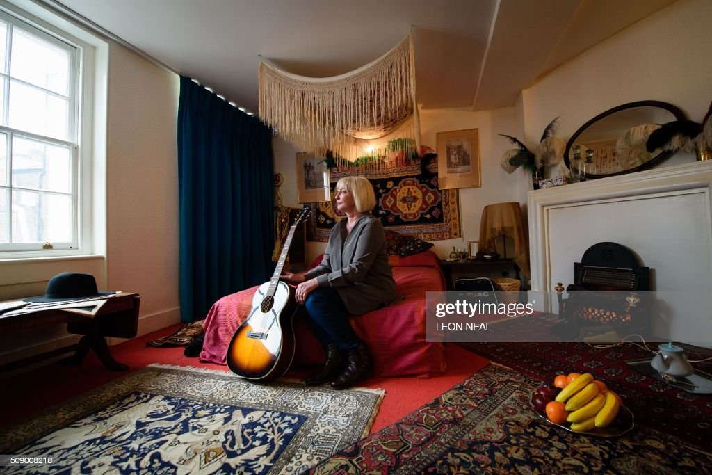 Kathy Etchingham, the former girlfriend of US musician Jimi Hendrix, poses for photographs in his former bedroom in central London, on February 8, 2016, to promote a forthcoming exhibition. Located above the Handel House museum, Hendrix's former bedroom has been dressed to resemble how it was when he lived there in 1968-69. From February 10, 2016, the upper floor rooms of 23 Brook Street, will be open to the public, and includes galleries of images and videos showing his story. / AFP / LEON NEAL