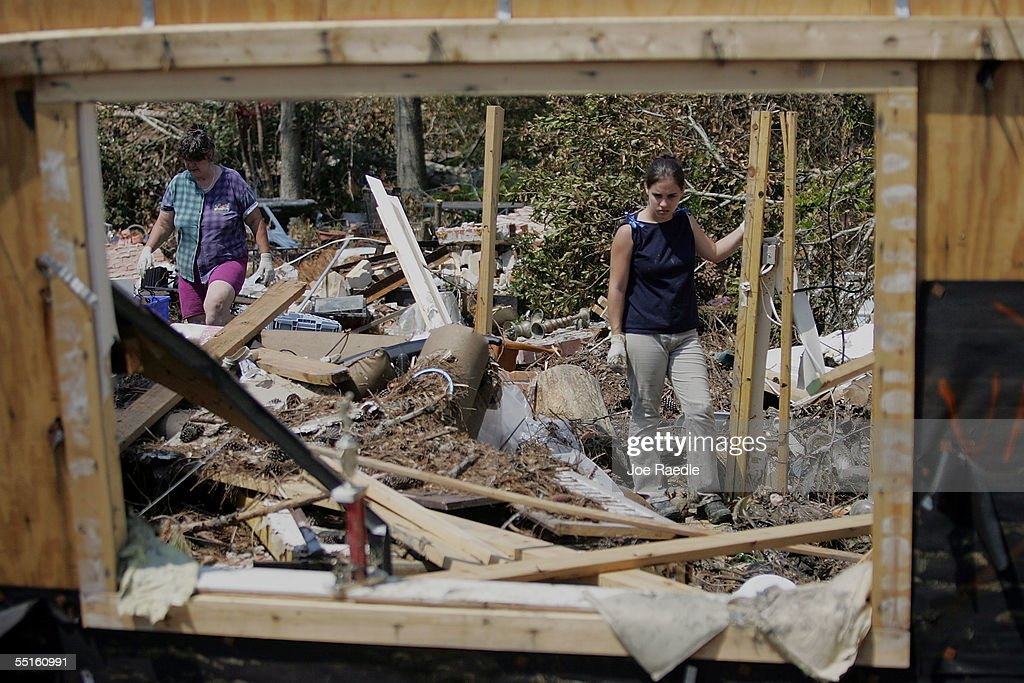 Kathy Everard and her granddaughter Rebecca McIntosh try to salvage items from their home after it was destroyed during Hurricane Katrina September 6...