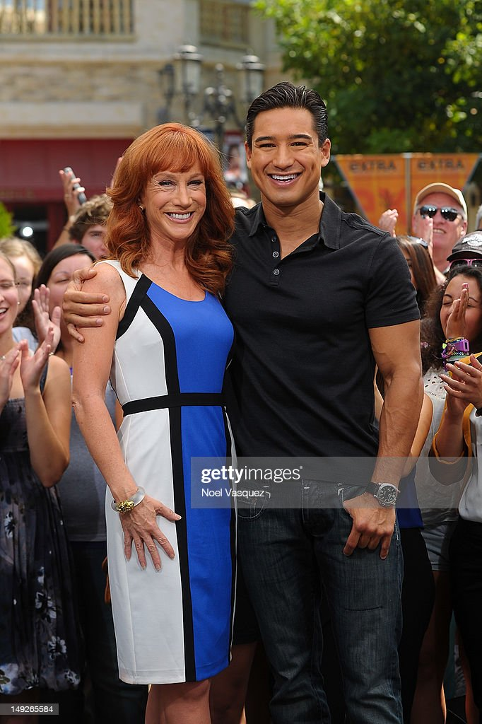 Kathy Griffin (L) and Mario Lopez visit 'Extra' at The Grove on July 25, 2012 in Los Angeles, California.
