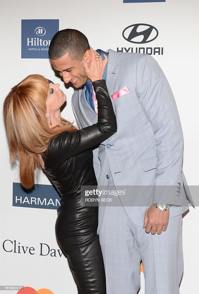 Kathy Griffin and NFL player Colin Kaepernick arrive for the Clive Davis & The Recording Academy's 2013 Pre-Grammy Gala And Salute To Industry Icons in Beverly Hills, California, February 9, 2013. AFP PHOTO Robyn BECK