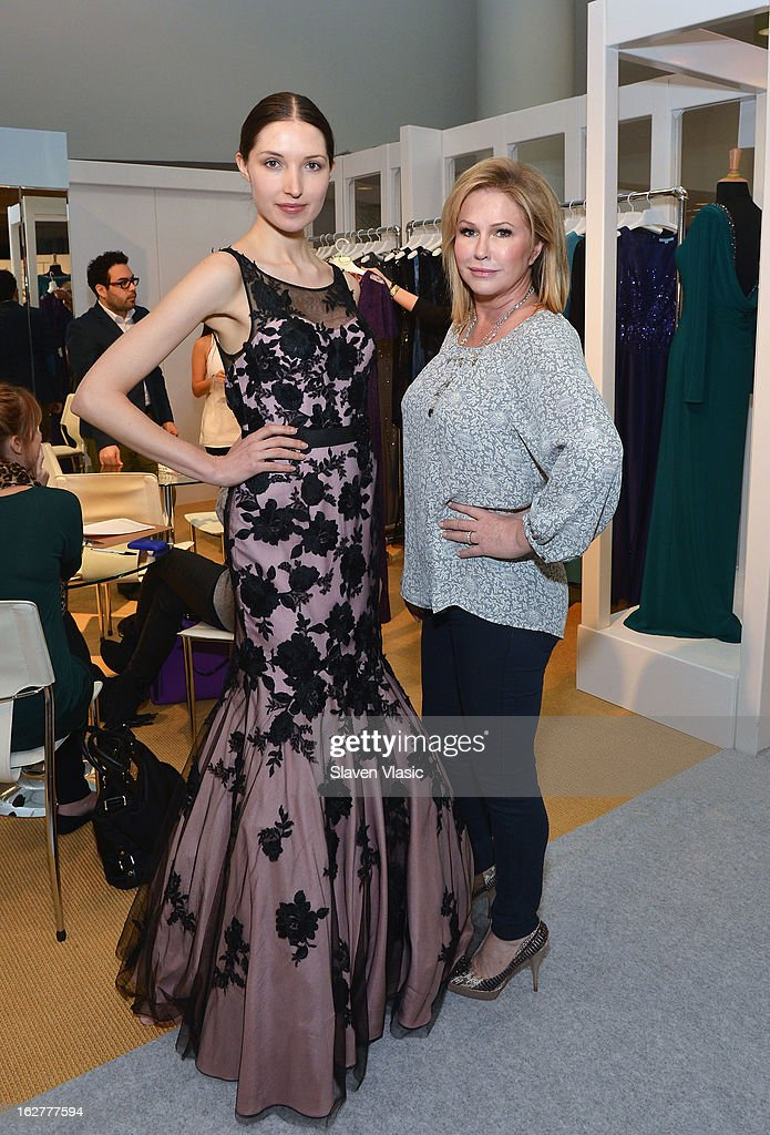 Kathy Hilton (R) and a model wearing her creation attend Kathy Hilton Fall 2013 Collection Preview at the Coterie International Fashion Exhibition at Jacob Javitz Center on February 26, 2013 in New York City.