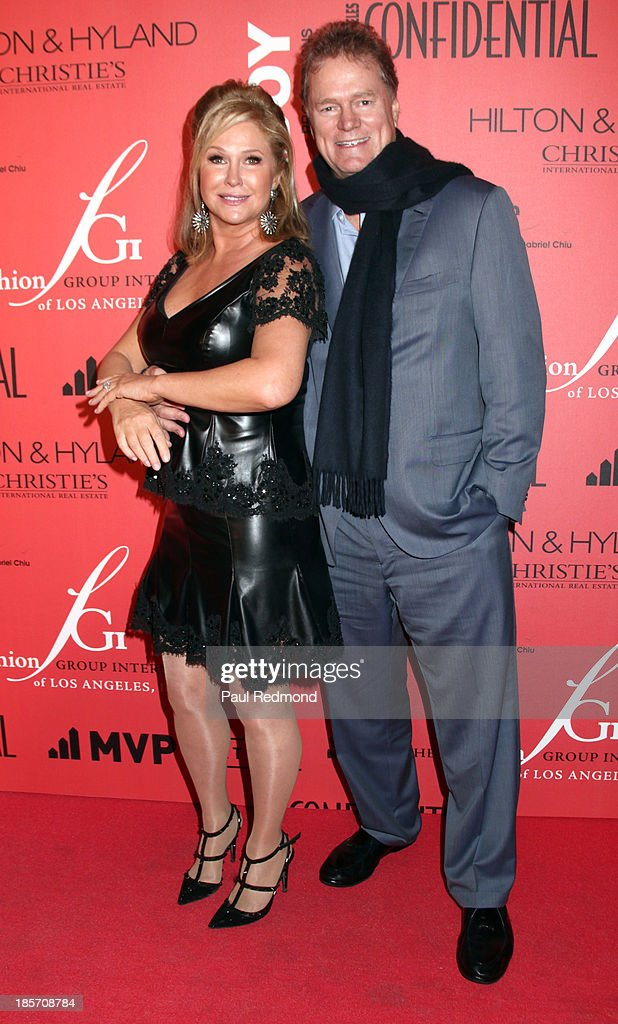 <a gi-track='captionPersonalityLinkClicked' href=/galleries/search?phrase=Kathy+Hilton&family=editorial&specificpeople=209306 ng-click='$event.stopPropagation()'>Kathy Hilton</a> and <a gi-track='captionPersonalityLinkClicked' href=/galleries/search?phrase=Rick+Hilton&family=editorial&specificpeople=207176 ng-click='$event.stopPropagation()'>Rick Hilton</a> arrive at FGILA's 5th Annual Designer & The Muse hosted by <a gi-track='captionPersonalityLinkClicked' href=/galleries/search?phrase=Kathy+Hilton&family=editorial&specificpeople=209306 ng-click='$event.stopPropagation()'>Kathy Hilton</a> at Mr. C Beverly Hills on October 23, 2013 in Beverly Hills, California.