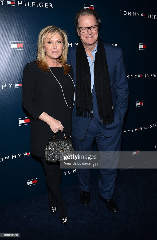 Kathy Hilton (L) and Rick Hilton arrive at the Tommy Hilfiger West Coast Flagship Grand Opening Event at Tommy Hilfiger West Hollywood on February 13, 2013 in West Hollywood, California.
