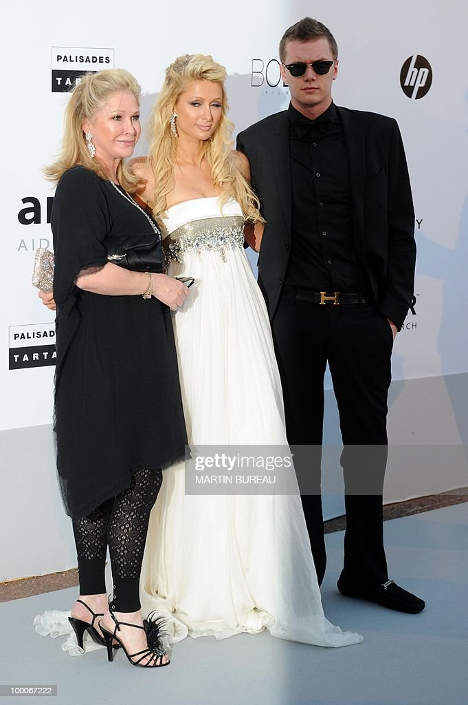 US Kathy Hilton, Paris Hilton and Barron Nicholas Hilton pose while arriving to attend the 2010 amfAR's Cinema Against Aids benefit gala on May 20, 2010 in Antibes, southeastern France.