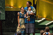Kathy JetnilKijiner a civil society representative from the Marshall Islands recieves a standing ovation with her husband and child after speaking at...