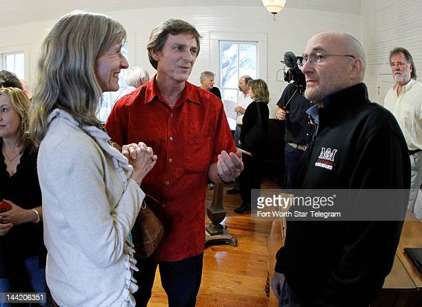 Kathy left and Randy Daniell speak with Phil Collins about his fascination with the Alamo in Buffalo Gap Texas May 8 2012