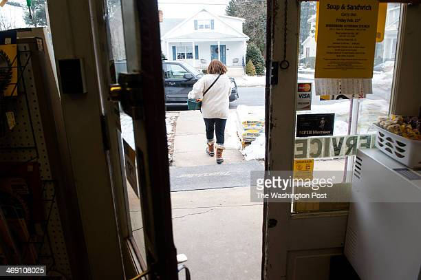 Kathy Lertora of Keymar MD leaves T R Saylor Co a family owned hardware store with gloves for her husband plastic planters that she'll use as water...