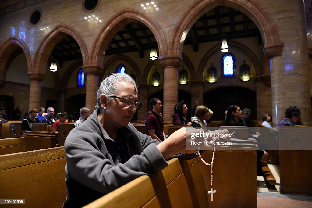 Kathy Montoya prays the rosary during Ash Wednesday mass at Holy Ghost Catholic Church on February 10, 2016 in Denver, Colorado.