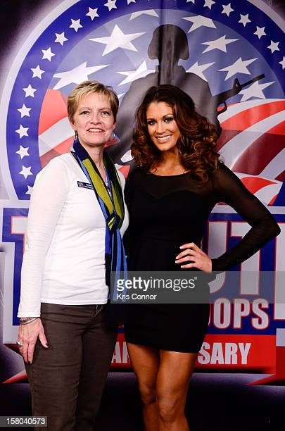 Kathy Nelson and WWE Dive Eve Torres pose for a photo during 10th anniversary of WWE Tribute to the Troops at Norfolk Scope Arena on December 9 2012...