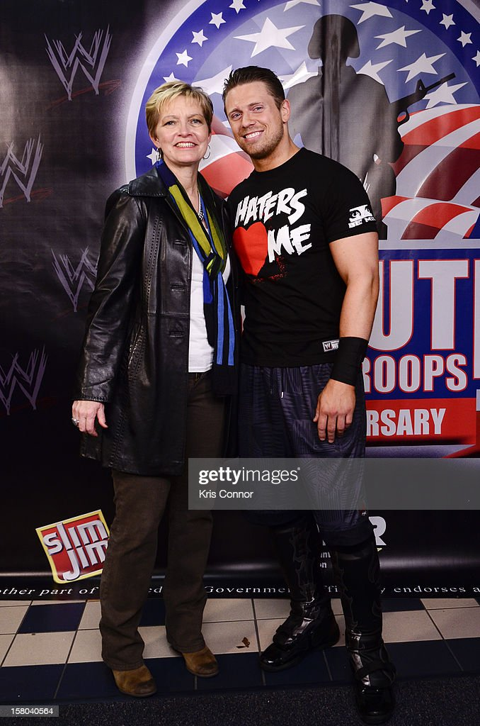 Kathy Nelson and WWE Superstar The Miz pose for a photo during the 10th anniversary of WWE Tribute to the Troops at Norfolk Scope Arena on December 9, 2012 in Norfolk, Virginia.