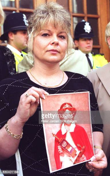 Kathy Tanner of Oshawa Ontario Canada holds a picture of her mother Geraldine Krawchuck as she joins a demonstration against the disgraced...