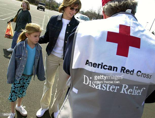 Kathy Witt and her daughter Leslie speak with a Red Cross worker after donating 'comfort' items for US military troops deployed overseas March 22...