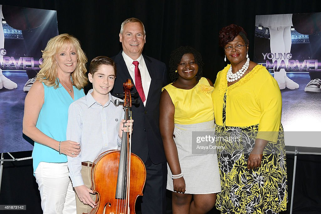 Kathy Zandieh, Charlie Zandieh, Scott Woodward, Ovation, SVP of Programming and Production, Mae Ya Carter and Ina Carter pose backstage for the Ovation TV's 'Young Marvels' panel of the 2014 Summer Television Critics Association at The Beverly Hilton Hotel on July 8, 2014 in Beverly Hills, California.