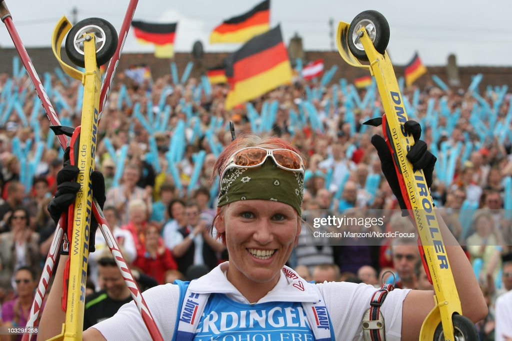 Kati Wilhelm of Germany celebrates her victory in the farewellrace at the 6th ODLO City Biathlon on August 08 2010 in Puettlingen Germany