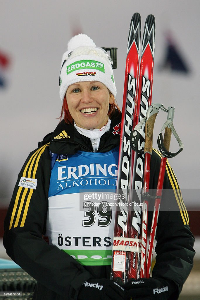 Kati Wilhelm of Germany looks on during the Flower Ceremony of Women's 75 km Sprint of the EON Ruhrgas IBU Biathlon World Cup on December 5 2009 in...