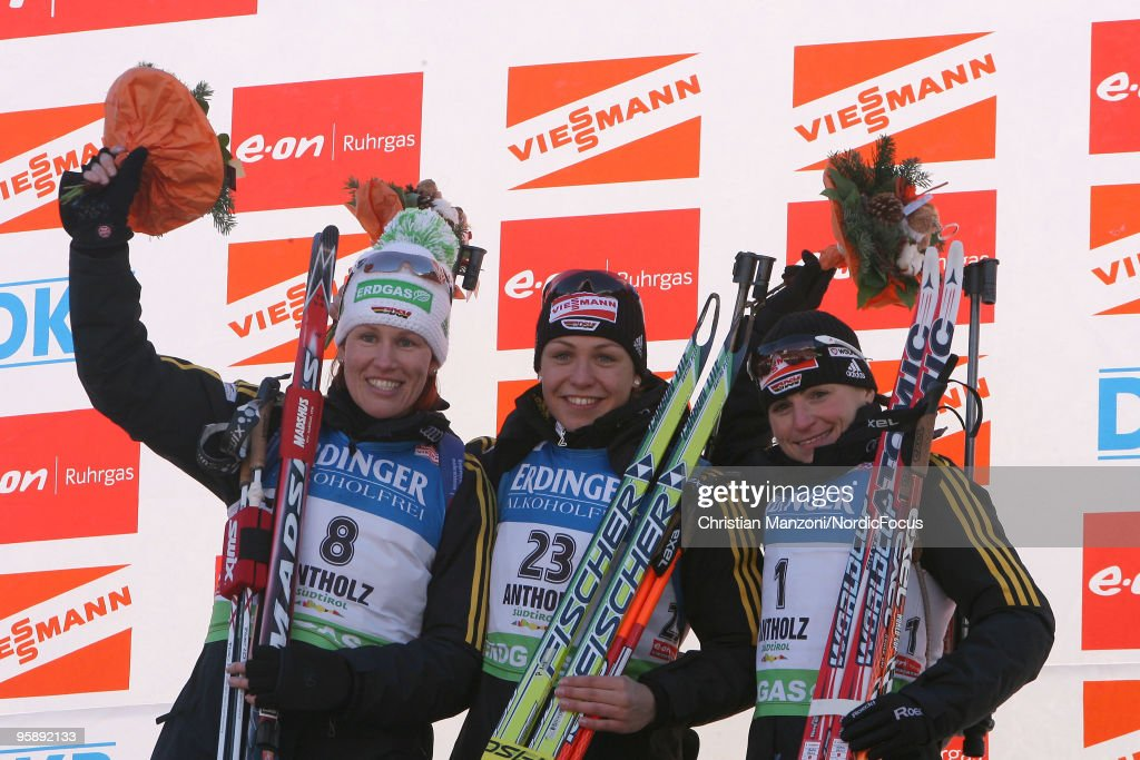 Kati Wilhelm of Germany Magdalena Neuner of Germany and Andrea Henkel of Germany celebrate at the flower ceremony after the women's individual in the...