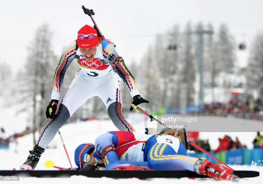Kati Wilhelm of Germany smiles as she approaches Anna Carin Olofsson of Sweden at the finsh line in the Womens Biathlon 125km Mass Start Final on Day...