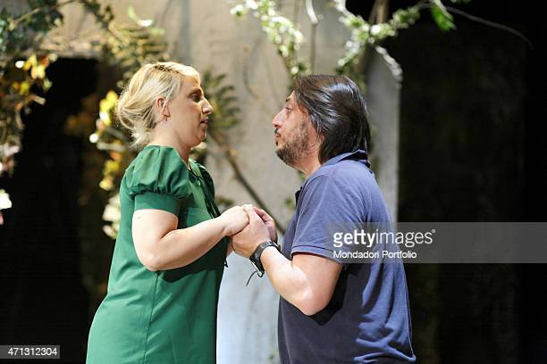 Katia Follesa and Alessandro Betti hold their hands during the rehearsal of A Midsummer Night's Dream by William Shakespeare in the comic adaptation...