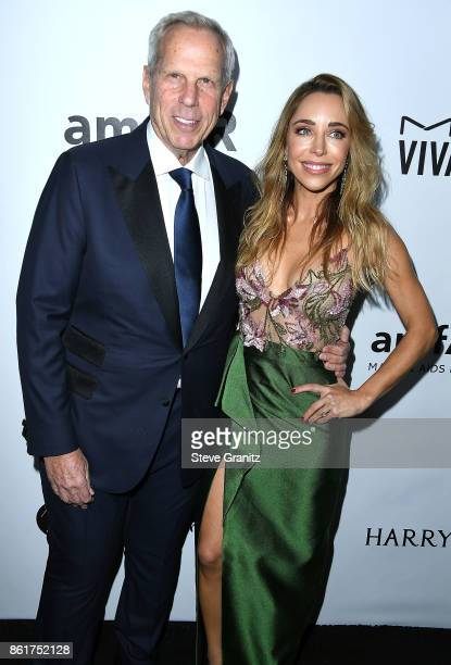 Katia Francesconi Steve Tisch arrives at the amfAR Los Angeles 2017 at Ron Burkleâs Green Acres Estate on October 13 2017 in Beverly Hills Californi